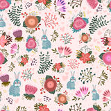 Cute seamless pattern with flowers and hares Stock Image