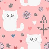 Cute seamless pattern with funny cats, flowers, hearts and paw prints. Royalty Free Stock Photo