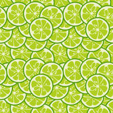 Cute seamless pattern with green lime slices Stock Images