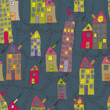 Seamless pattern of hand drawn houses in night town Stock Photography