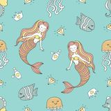 Cute seamless pattern with mermaids and sea animals Stock Photos