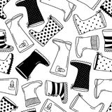 Cute seamless pattern with monochrome hand drawn rubber boots. Cute seamless pattern with contrast monochrome hand drawn rubber boots, can be used for decoration Royalty Free Stock Photo
