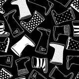 Cute seamless pattern with monochrome hand drawn rubber boots. Cute seamless pattern with contrast monochrome hand drawn rubber boots, can be used for decoration Stock Images