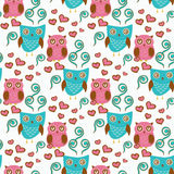 Cute seamless pattern with owls couple. Blue and pink owls. Royalty Free Stock Photo