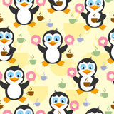 Cute seamless pattern with penguin, donuts and coffee on a yellow background. Royalty Free Stock Photo