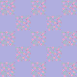 Cute seamless pattern of pink flowers on the blue background Royalty Free Stock Photo
