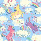 Cute seamless pattern with rainbow unicorns. In the clouds. Vector illustration