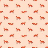 Cute seamless pattern with red foxes on pink background. Cute seamless pattern with red foxes. Vector illustration for decoration for textile, notebooks Stock Images