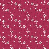 Cute seamless pattern with small flowers on a red background Stock Photo