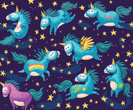 Cute seamless pattern with unicorns in the night sky Royalty Free Stock Photos