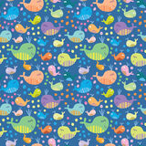 Cute seamless pattern with whales. Cartoon marine seamless pattern for childish wallpapers with whales Royalty Free Stock Images