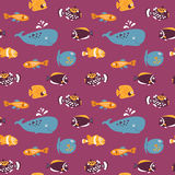 Cute seamless texture with cartoon fish on purple background Stock Image