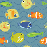 Cute seamless texture with coral fishes on a blue background Royalty Free Stock Photography