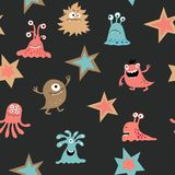 Cute seamless texture with decorative aliens and stars Royalty Free Stock Image