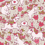 Cute seamless texture with lovely unicorns and flowers Stock Photography