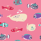 Cute seamless texture with tropical fish on a pink background Royalty Free Stock Image