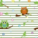 Seamless tiling texture with Owls and flowers Stock Image