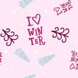 Cute seamless winter pattern with decorative elements: spruce trees and handlettering i love winter. Stock Photos