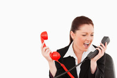 Cute secretary driven crazy by the phone calls Stock Photo