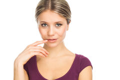 Cute and seductress. Close up portrait of a charming young woman, on white Royalty Free Stock Photo