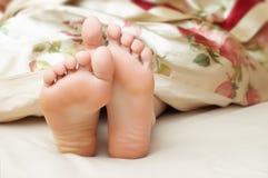 Cute seeping feet Stock Photos