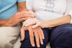 Cute senior couple holding hands Stock Images