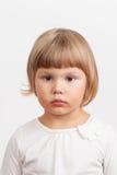Cute serious Caucasian little girl, closeup portrait Stock Image