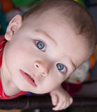 Cute serious little boy with blue eyes. Stock Photo