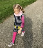 Cute seroius girl walking on asphalt walk Royalty Free Stock Photography