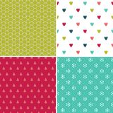 Cute set of seamless holiday backgrounds red white green. Vector set of seamless geometric holiday backgrounds in red, white and mint with hearts, trees Royalty Free Stock Photography