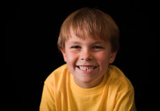 Cute seven year old boy in yellow shirt Stock Photo
