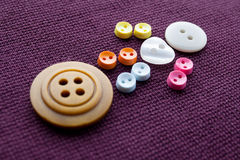 Cute sewing buttons man. Funny character with love white heart button. violet textile background. macro view, soft focus Royalty Free Stock Images