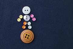 Cute sewing buttons man. Funny character with love white heart button. violet textile background. macro view, soft focus.  Royalty Free Stock Photos
