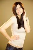 Cute brunette posing in studio happy smiling Stock Photos