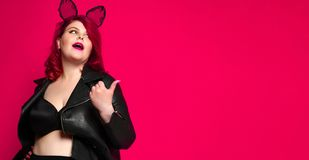 Free Cute Sexy Plus Size Brunette With Black Bunny Ears In Leather Jacket And Underwear Posing On Red Background Stock Image - 155351591