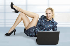 Cute sexy woman with laptop computer Stock Image