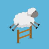 Cute sheep jumping over fence isolated on blue background. Counting sheep to fall asleep. Royalty Free Stock Photo