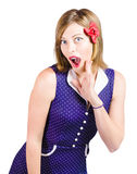 Cute shocked girl with pinup make-up and hairstyle. Isolated photo of a beautiful girl expressing shock with wide open mouth, pinup make-up and hairstyle on Royalty Free Stock Photography