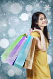 Cute shopper with snowflake background Stock Images