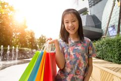 Cute shopping girl holding shopping bags royalty free stock image