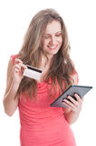 Cute shopping girl using a credit card Stock Images