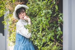 Cute short haired Asian women, Thai people, dressed in Japanese cosplay costumes in a concept outdoor during the daytime. Cute short haired Asian women, Thai royalty free stock image