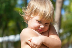 Cute shy Caucasian blond baby girl portrait Royalty Free Stock Photography