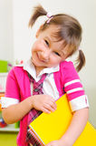 Cute shy girl with notebook folder Royalty Free Stock Photos