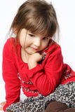 Shy Little Girl. Cute shy little girl posing on white background royalty free stock photos