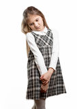 Cute shy schoolgirl against isolated background Royalty Free Stock Photography