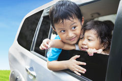 Cute sibling in car Royalty Free Stock Photography