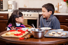 Cute siblings baking cookies Royalty Free Stock Images