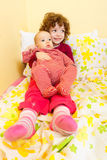 Cute siblings in bed Stock Photo