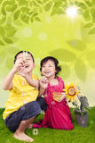 Cute siblings blowing bubbles Royalty Free Stock Image
